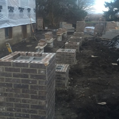 Getting the piers bricked and ready for the porch.